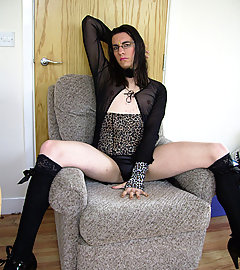 An exotic looking TGirl with a nice cock and sexy outfit on