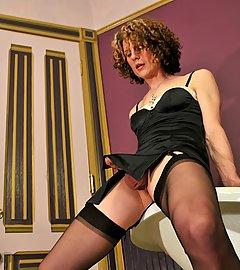 Super sexy Delia in slinky slip and sheer black nylon stockings.