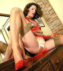Striking stockinged beauty with a cock underneath her gold satin panties.