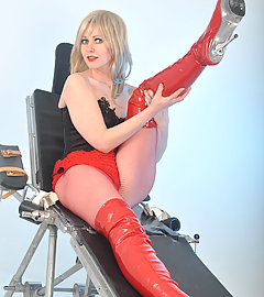 Gorgeous Helga is wearing some leather PVC boots and looking horny