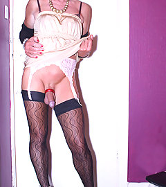 Kims wearing a gorgeous white outfit and playing with her TGirl cock.